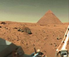 photograph of a pyramid on Mars. The  pyramid structures are aligned in perfectly with the pyramids in Egypt on Earth. Also, NASA image analysists have confirmed that the structure even has teeth in it's mouth, bilaterally crossed lines above the eyes, bilateral symmetry of the face and regular lateral stripes on the head-dress confirming it must be an artifical structure. What's more, the Giza monuments on Earth form an accurate terrestrial map of the three stars of Orion's belt & therefore