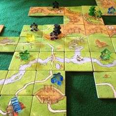 Carcasonne. Place tiles to expand the map. Another gateway game for to heavier boardgames and also played by many who never want anything more.