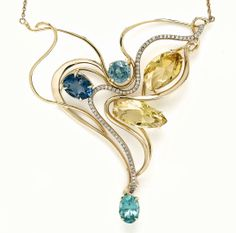 Made by Marla Trudine. Art Nouveau Golden beryl, Blue Zircon, Apatite, Topaz 18k Gold, Diamonds