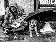 - United Kingdom, London, August 2013. A young homeless man sits in the street with his canine companion. Joblessness and homelessness have become an ever greater challenge since the onset of the economic crisis five years ago.