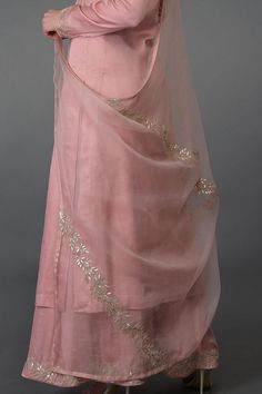 From our Indian Spring Collection, this Pearl Pink kurta and farshi palazzo suit is adorned with beautiful rose gold gota patti hand embroidery. The kurta and farshi ( wide leg palazzo pants) are crafted in fine bemberg modal and the dupatta is c Kurti Designs Party Wear, Kurta Designs, Blouse Designs, Indian Dresses, Indian Outfits, Gota Patti Suits, Embroidery Suits Design, Hand Embroidery, Embroidery Designs