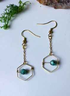 ※ Tiny turquoise pearls earrings  ※ Total lenght : 4 cm Material : Brass gold ton. Pearls comes from Belgium :)  ※Each stone is different, there may