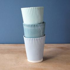porcelain tumblers in mint, teal, periwinkle