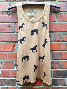 the grass is always greener in the 'off to pasture' tank. horse lovers unite in this adorable animal graphic! pair with an epic skirt, cut-offs, jeans, or nothin at all. this chestnut cutie is so vers