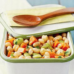 Cilantro Three-Bean Salad Try this snazzy side dish recipe that features garbanzo beans, small white beans, and baby limas fired up with jalapeno or serrano peppers and seasoned with cilantro and a low-carb dressing.