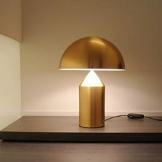 The Oluce Atollo 233 Oro gold is an extravagant table lamp. This Oluce lamp is equipped with a cord dimmer. Interior Lighting, Home Lighting, Lighting Design, Light Fittings, Light Fixtures, Light Table, Desk Light, Atollo Lamp, Lampe Decoration