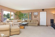 Living Room. This lovely home is listed for $349,900; Bedrooms: 4; Total Baths: 2; Garage:4; Year Built: 1975 Sq. Feet: 2,126; Lot size: 0.20 acres; Heat: Baseboard. To learn more about the property, visit: www.lesbaileyteam.com