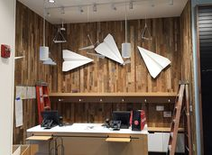 """""""Paper Planes"""" by Bruce Gray as powder coated steel  wall mounts"""