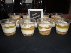 Desserts: individual lemon cheesecakes. Polaroid-style labels tied in with party invitations/theme.