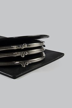 Half Measures Peel Back Clutch - A sculptural flat clutch with three kiss-lock closure side compartments and single back zip compartment, constructed from semi-gloss vegetable tanned leather. Vegetable Tanned Leather, Kiss, Card Holder, Closure, Sculpture, Flat, Bass, A Kiss, Sculpting