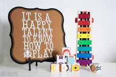 Playroom quote with the Cricut Storybook font. Corkboard by Martha Stewart Office.