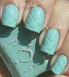 Manicure - Embossed quilt pattern in tiffany blue using striping tape. Elegant nail art.