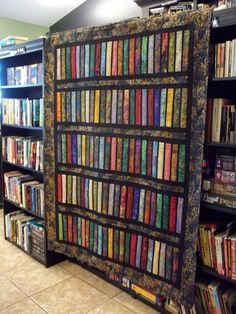 """One of our bookstore customers brought in this amazing """"bookshelf quilt"""" to show to us today - WOW! What a work of ART! www.sandmanbooks.com"""