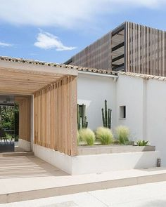House Architecture Home style design The entrance way has wooden panelling with a few plants e. cactus and bushes. The house has a square and rectangle style. Architecture Design, Contemporary Architecture, Contemporary Design, Exterior Design, Interior And Exterior, Entrance Ways, House Goals, Modern House Design, My Dream Home