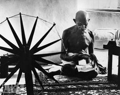 The Great Soul: Photo by Margaret Bourke-White, 1046  In a iconic 1946 photo, Mohandas Gandhi poses alongside his spinning wheel, a symbol of his nonviolent movement for India's independence from Great Britain.