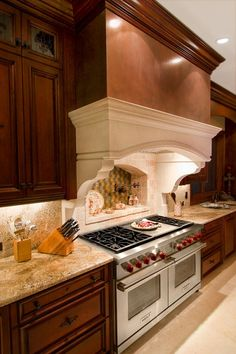 live the cabinets with glad way uppers, granite color, hood is beautiful.  Wolfe range.  Backsplash.. Good lookin'!