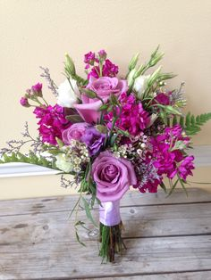 Shades of purple and lavender for a garden style bridesmaid bouquet  Floral Impressions Hunt Valley, MD