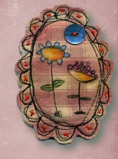 Stamped and stitched fabric brooch