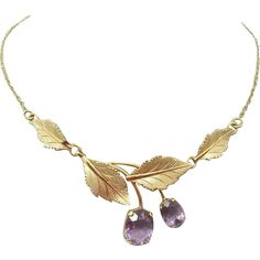 14 Karat Gold Amethyst Necklace with Brushed Leaves. Dates to the 1940s.