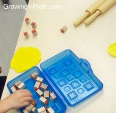 play-doh + alphabet stamps