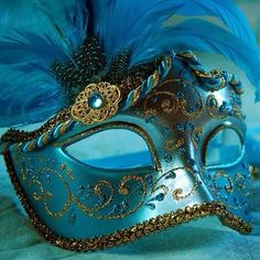 Blue and Gold Masquerade mask with blue feathers!