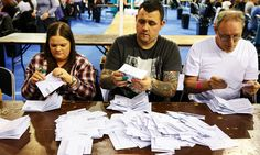 Count staff check and verify ballot papers at the Glasgow count centre at the Emirates Arena, Glasgow, Scotland, on June 23, 2016 after polls closed in the referendum on whether the UK will remain or stay in the European Union (EU). Millions of Britons began voting Thursday in a bitterly-fought, knife-edge referendum that could tear up the island nation's EU membership and spark the greatest emergency of the bloc's 60-year history. / AFP PHOTO / Robert Perry