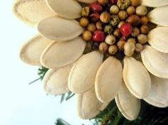 DIY Pumpkin Seed Flower Christmas Ornament | www.FabArtDIY.com LIKE Us on Facebook ==> https://www.facebook.com/FabArtDIY