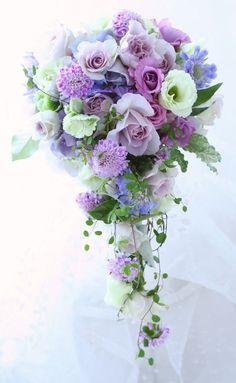 Soft lavenders create a romantic teardrop bouquet
