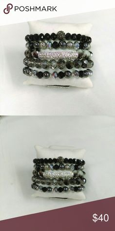 NWT Black Stack Bracelet Set New and never worn and made to coordinate with blacks, gray and silvers. 5-piece stack set. Deja Vous Jewelry Bracelets