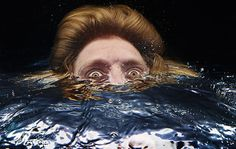 Bizarre Portraits of People Poking Their Heads Underwater face2 mini