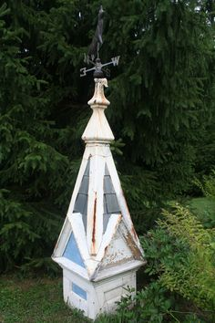 cupola from an old dairy barn in the garden. Please, oh please hide that ugly well pump.