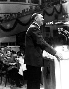Adolf Hitler making a speech with a happy Joseph Goebels looking on