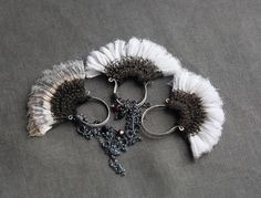 three thistles | Flickr - Photo Sharing! This artist does some amazing work...it's both jewellery and textile art....I love it!!