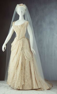 Wedding Dress: 1887, Australian, silk faille with machine-made Valencienne style lace trim, heavily beaded with large 'pearls' and small glass beads.