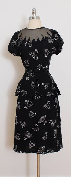 ➳ vintage 1940s dress * black polyester * white fan print * unique illusion neckline * detachable belt * metal side zipper condition | excellent fits like medium dress length 42.5 bodice 17 bust 38 waist 28-29 hips 38 ➳ shop http://www.etsy.com/shop/millstreetvintage?ref=si_shop ➳ shop policies http://www.etsy.com/shop/millstreetvintage/policy twitter | MillStVintage facebook | millstreetvintage instagram | millstreetvintage 5818/1...