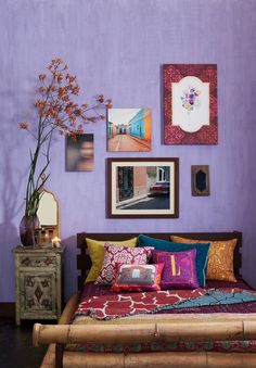 Opt for a tropical color or a hue rich with lightness, like a purple pastel, and paint an accent wall in your bedroom or living space. Once finished, position a collection of images on your wall, accenting the bright color. Add natural elements like florals, wood frames, or even raffia baskets, which bring a trip to the tropics to mind.