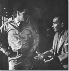 A rare behind the scenes shot of Elvis talking to Producer Hal Wallis. 1960   | When Elvis returned from the army in 1960, Hal Wallis was waiting with a new four-year contract that he had prepared. In addition to making four pictures for Wallis, Elvis would also be allowed to do two outside pictures the first year, one each in the second and third years, and two in the fourth.    : http://movies.elvispresley.com