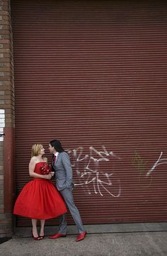 red wedding dress.. Love the grooms grey suit, makes it more down to earth.
