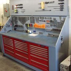 mightymaxcarts: Great idea to put the toolbox cabinets under the workbench. #tools #garage #goodidea #workbench