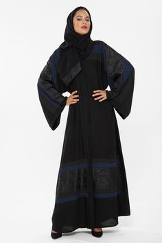 This abaya from o3bay is truly a sophisticated design with a camo pattern interlined on the sleeves and the bottom bordered with blue colour to give it that sensational look and feel.