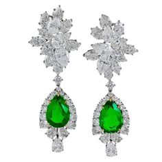 Harry Winston emerald Diamond Cluster Pendant Earrings | From a unique collection of vintage dangle-earrings at https://www.1stdibs.com/jewelry/earrings/dangle-earrings/