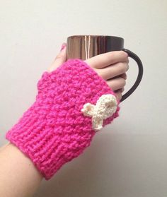 Show your support by wearing these breast cancer fingerless gloves. Perfect for any season; especially October!  Made with soft bright pink yarn that is doubled and accented with a white knitted breast cancer applique.  They come in the following sizes:  Baby- ages 6-12 months Toddler- ages 12 months - 3 years  Child- ages 3-6+ years Adult- one size fits most  You get 2 gloves in this set- 1 for the right hand, 1 for the left hand.  #breastcancer #coupon #october #pink