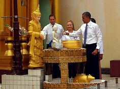 A photo provided by the Myanmar News Agency MNA on 19 November 2012 shows US President Barack Obama (R) offering water to a Buddha statue as US Secratary of State Hillary Clinton