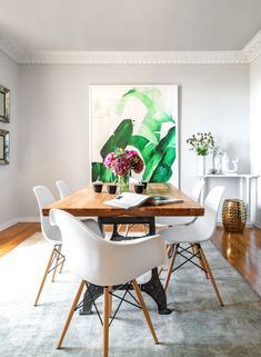 oversized art, eames chairs, wood table, gray walls general scheme for the dining room