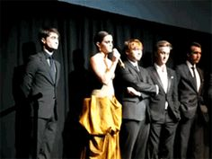 Tom looking at Emma while she makes a speech. And its obviously that he wants to be near her.... I think