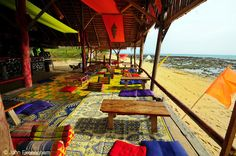 Klong Khong Beach, Koh Lanta, Thailand. Almost every resort on Klong Khong has a beach and sunset-viewing lounge like this, where some guests relax through the day, but most gather around sunset.