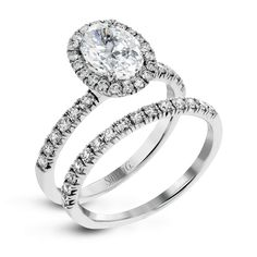 An exclusive design by Simon G., the MR2905 Engagement Set is a stunning piece of jewelry sure to please. Check out this designer piece today!