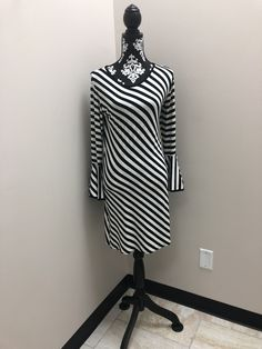 Slimming black and white dress with ruffle bell sleeve. Easy to dress up or down. Houndstooth Dress, Striped Dress, White Dress, Cowl Neck Dress, High Neck Dress, Bell Sleeve Dress, Bell Sleeves, Winter Dresses, Dress Up