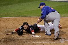 Cleveland Indians' Jason Kipnis scores past Chicago Cubs' Jon Lester during the fifth inning of Game 7 of the Major League Baseball World Series Wednesday, Nov. 2, 2016, in Cleveland.