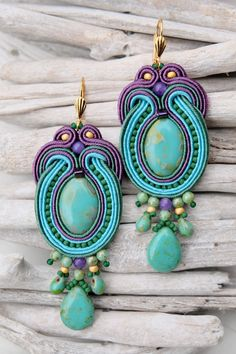 Boho statement soutache earrings in turquoise and green.  * material : satin cords, beads, suede  * hooks : metal  * back side : beige suede  * total size : 3.19 x 1.18 ( 8.1 x 3 cm )     All my jewellery has been IMPREGNATED with super nano protector against dirt and damp.  If you have any questions please dont hesitate to ask me.  If you like design but prefer different colours or beads I can make them for order.    If you want more of my earrings:  https://www.etsy.com/uk&#x...